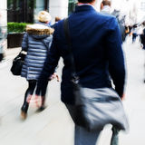 Walking commuters at rush hour Royalty Free Stock Photos