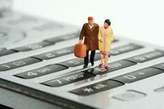 'Walking' on comunication. Model of a couple walking on a mobilephone keyword Royalty Free Stock Photos