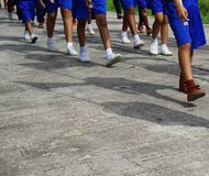 Walking on the concrete road. Student are Walking on the concrete road Royalty Free Stock Photos