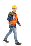 Walking construction worker with rope. Royalty Free Stock Photography