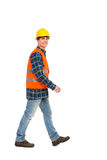 Walking construction worker. Royalty Free Stock Photography