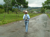 Walking country road. Girl wolking country road royalty free stock photos