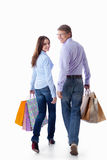 A walking couple with bags Stock Photo