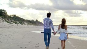 Walking couple on the beach stock footage