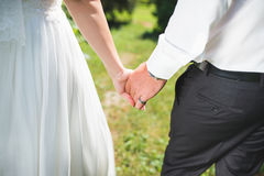 Walking Couple on Grass Stock Photos