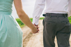 Walking couple holding hands Royalty Free Stock Image