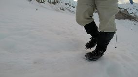 Walking on Crampons on Ice Slow Motion stock footage