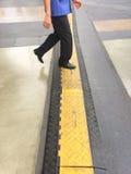 Walking Cross Line. A man walking cross line Stock Image