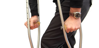 Walking with crutches Stock Photography