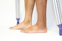 Walking on crutchs Stock Photos