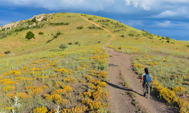 Walking on curvy dirt roads. Trekking adventure;walking on curvy dirt roads Stock Image
