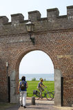 Walking and cycling in Harderwijk by the old city wall Royalty Free Stock Images