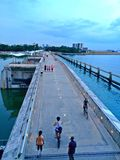 Walking and cycling on Marina Barrage royalty free stock photography