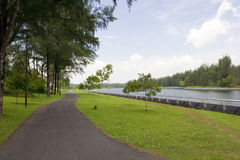 Walking and cycling path by the river Stock Photo
