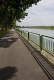 Walking and cycling path by the river Stock Image
