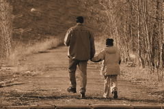 Walking with daddy. Walking with my Dad stock photos
