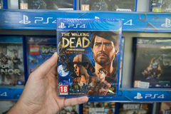 The walking dead a new frontier. Bratislava, Slovakia, circa april 2017: Man holding The walking dead a new frontier videogame on Sony Playstation 4 console in Royalty Free Stock Images