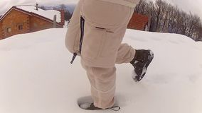 Walking in deep snow stock video footage