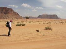 Walking in desert. Man walking in desert, Wadu Rum, Jordan Stock Photo