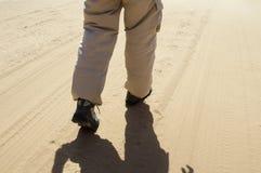 Walking through a desert stock photos