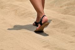 Walking in a desert. one more step in a hot sand stock photo