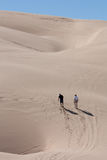 Walking through the desert Sand Dunes Royalty Free Stock Photo