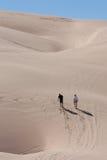 Walking through the desert Sand Dunes Royalty Free Stock Photo