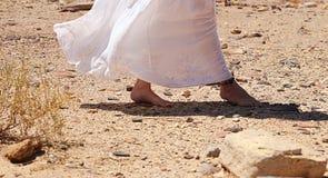 Walking in desert. Woman's feet Stock Images
