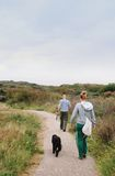 Walking the dog. Couple returning from a walk with the dog Stock Photos