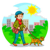 Walking the dog. Boy walking with his dog in the park Royalty Free Stock Photo