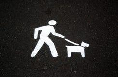 Walking the Dog. Walking, dog,exercise,leash, lead,sign, paint, road,bitumen,gravel,pavement,pet,offlead,onlead,offleash,offleash,symbol,directional,direction royalty free stock photography