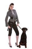 Walking the dog. Pretty fashionable woman letting her doberman pincher out Stock Photography