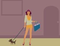 Walking a dog. Girl walking her dog in city Stock Image