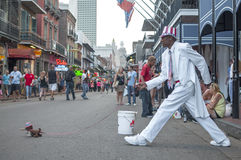 Walking dog on Bourbon Street Stock Photos