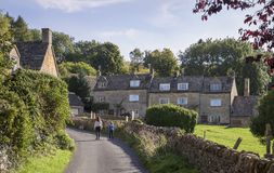 Walking dog in Cotswold village, England Stock Photography