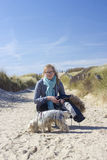 Walking with the dog in the dunes, Netherlands Royalty Free Stock Photo