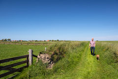 Walking with dog on Dutch Texel Stock Photos