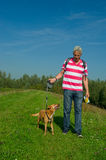 Walking the dog in nature Royalty Free Stock Image