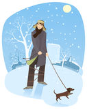 Walking a dog in winter. Illustration of a man walking a dog in wintertime Royalty Free Stock Photo