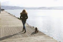 Walking the dog. Woman walking the dog, lifestyle Royalty Free Stock Photos
