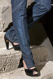 High Heals & Denim Stairs. Walking Down the cement Stairs Royalty Free Stock Image