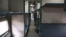 Walking down the narrow hallway of train in Amritsar. stock footage