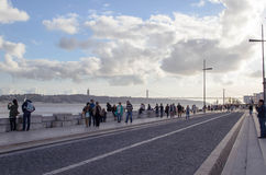 Walking down the seafront in Lisbon. Seafront in lisbon with people Royalty Free Stock Photos