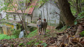 Walking down the sters to the water mill stock video