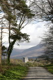Walking down to the castle. Ross Castle in mountains, kerry county, ireland Stock Image