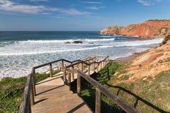 Walking down on wooden footbridge to beautiful amado beach on atlantic coast Stock Photo