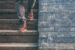 Walking downstairs: close-up view of man`s leather shoes Stock Images