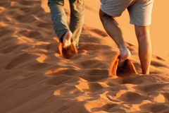 Walking on Dune 45, Namib Naukluft National Park, Namibia stock photo