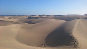 Walking through the dunes of Maspalomas royalty free stock images