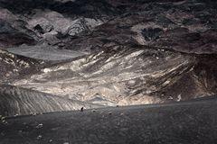 Walking on the edge. Of Ubehebe Crater in Death Valley Nevada Royalty Free Stock Images